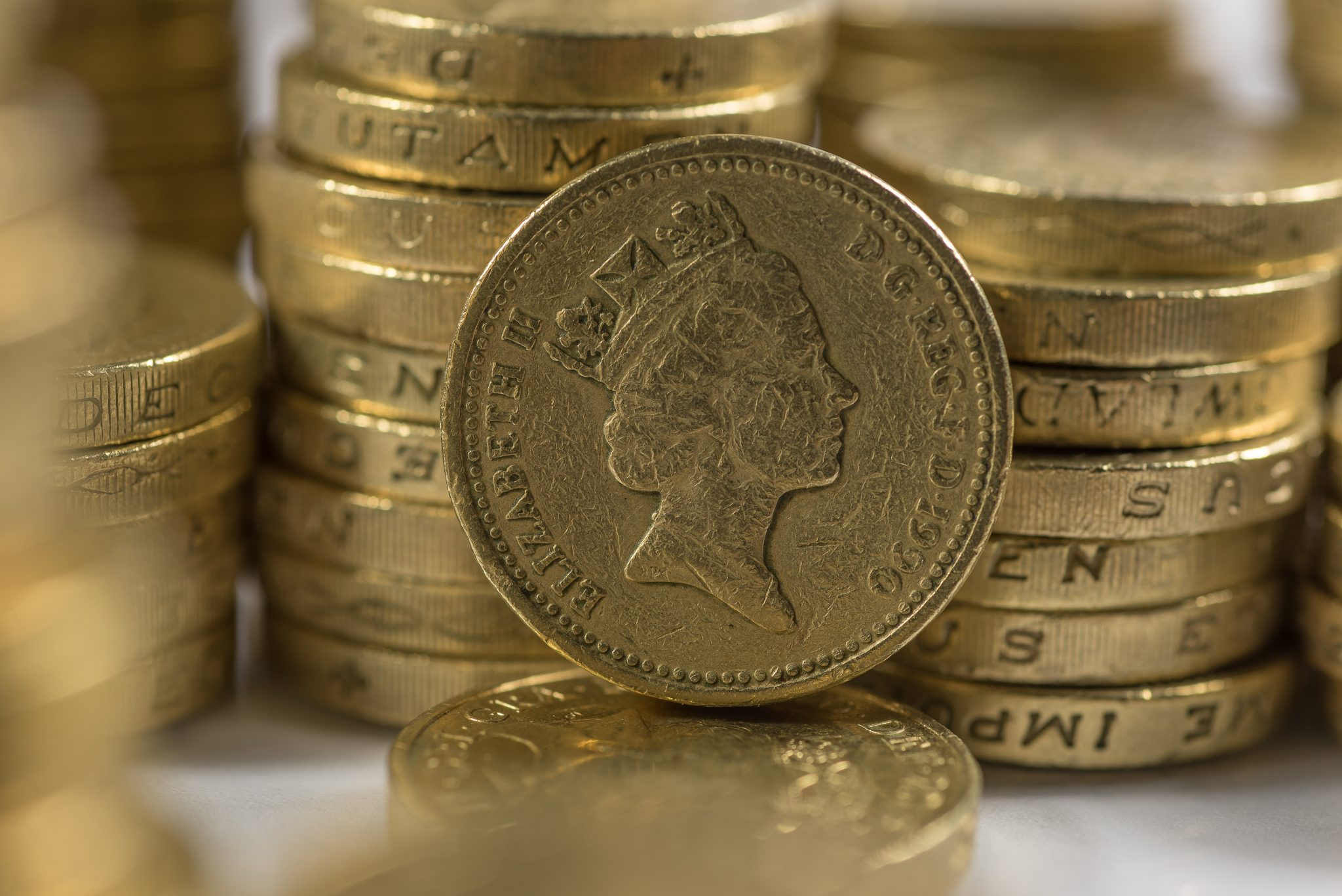 closeup shot of a pile of pound coins
