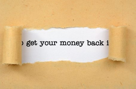 get your money back text revealed by ripped paper