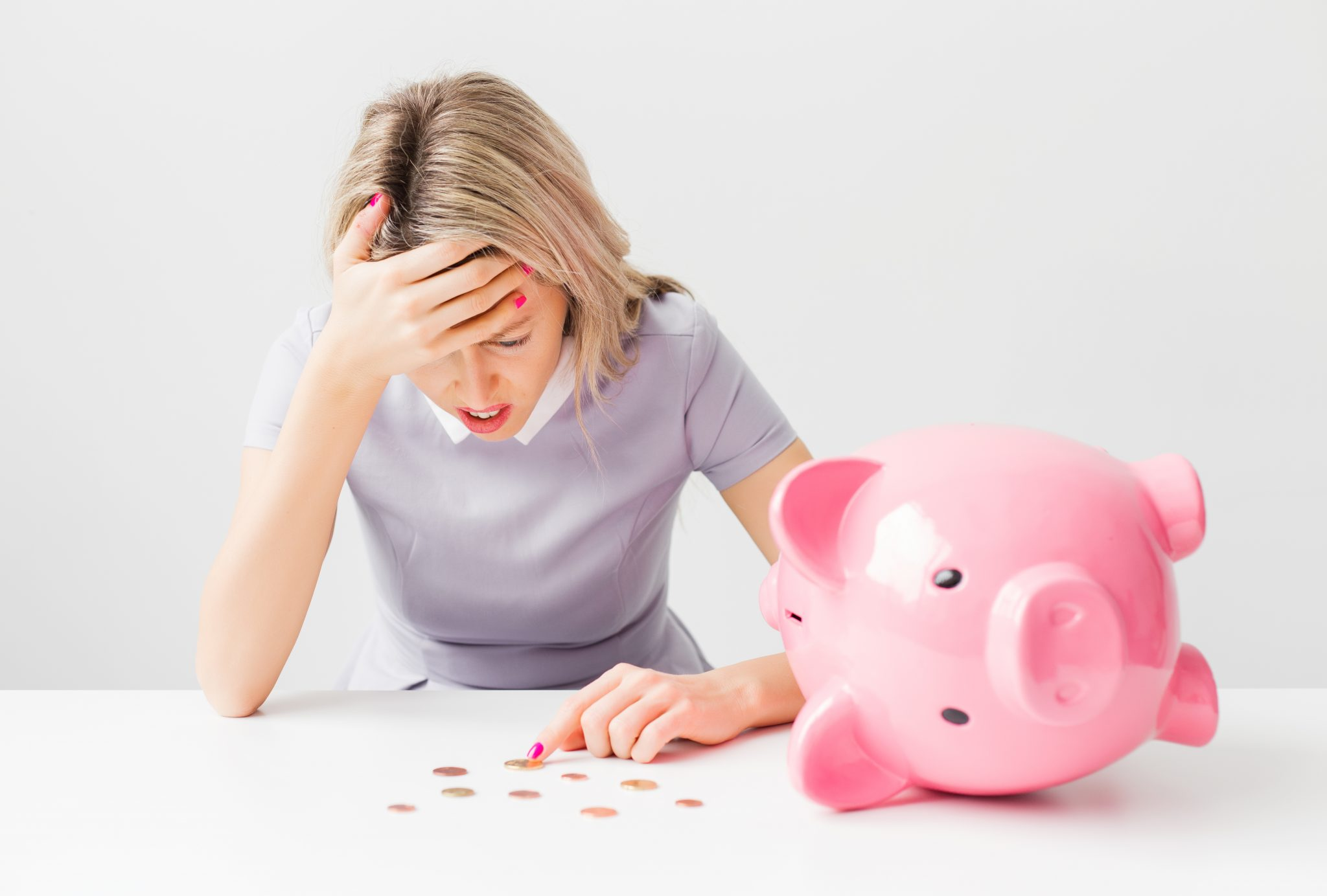 A woman stressed about money