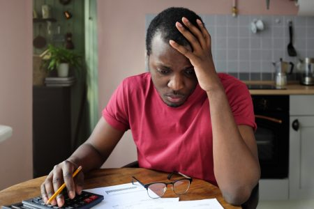 a young man checking financial paperwork
