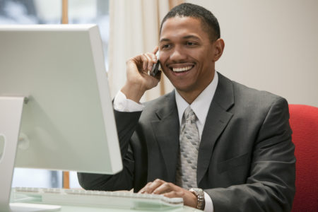 PPI specialist working at a computer taking a phone call