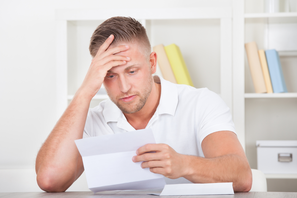 confused man looking at a ppi claim form
