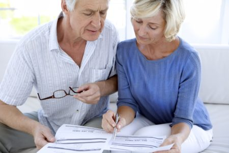 Elderly couple filling out PPI claim forms
