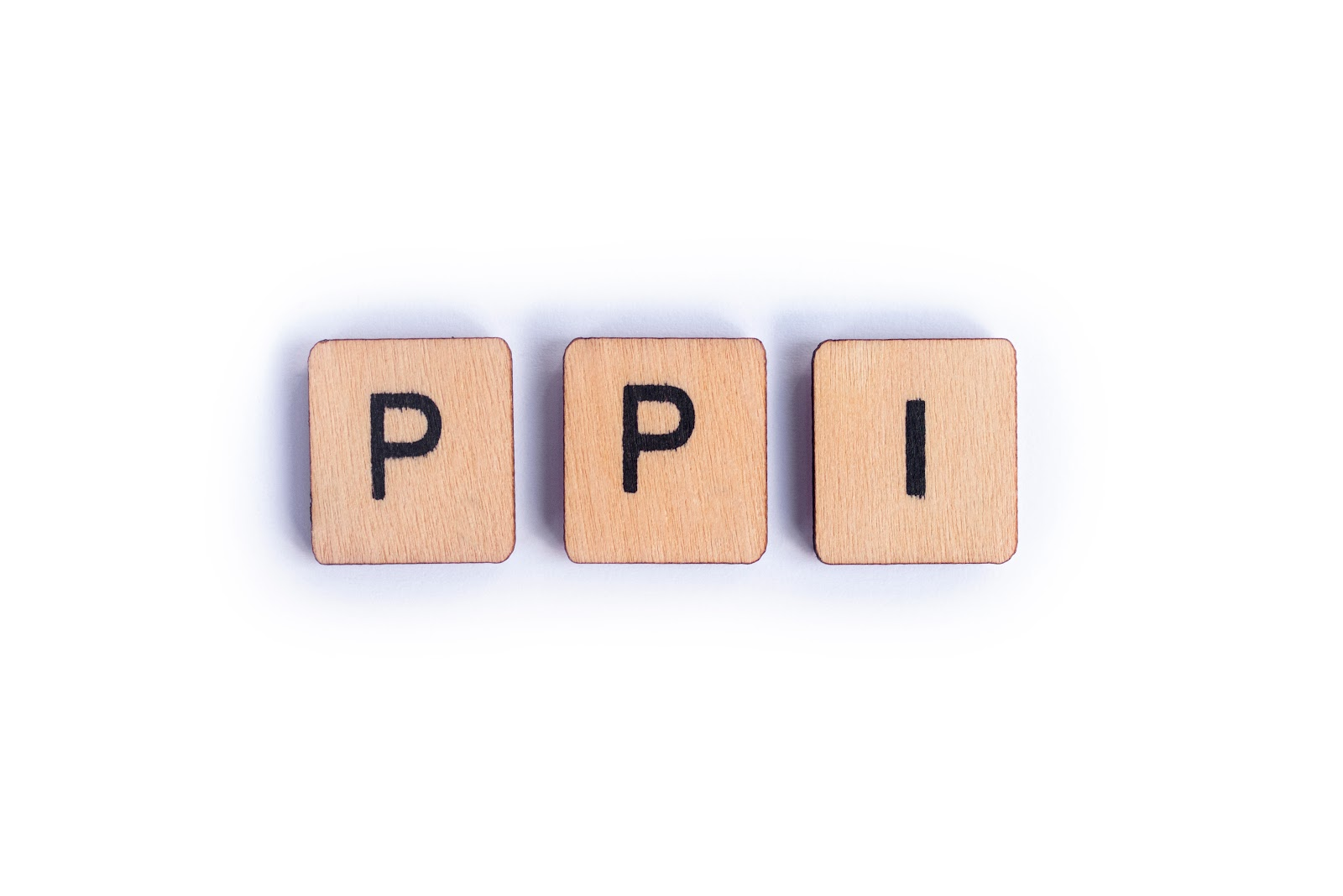 wooden blocks with the letters PPI on them