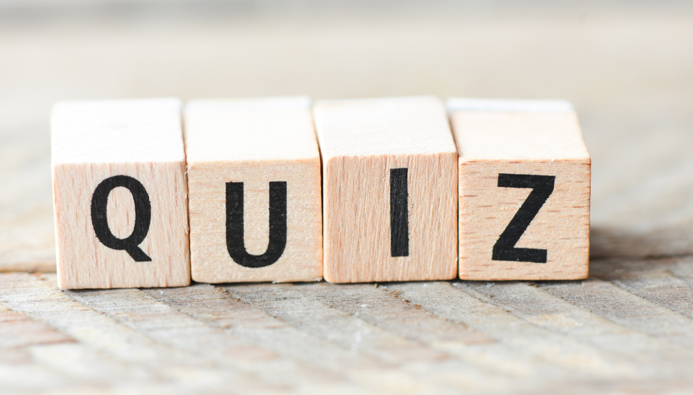 Quiz written on wooden blocks on light wood table