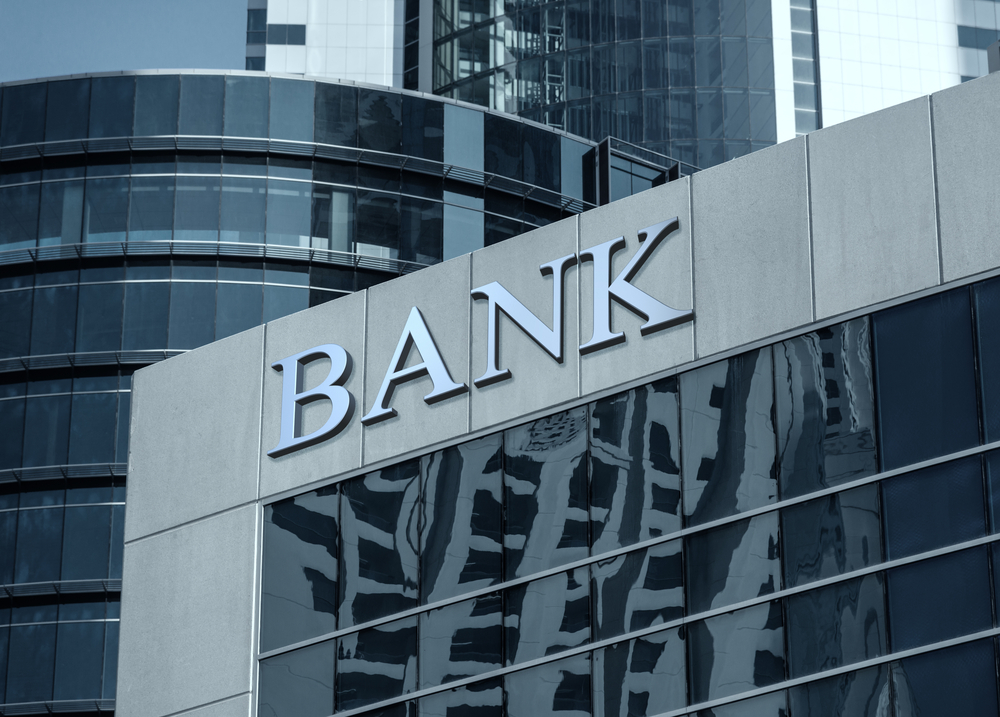 "exterier view of a modern building with a large ""bank"" sign on it"